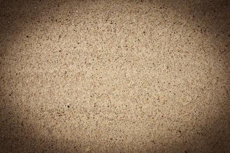 Bright fine-grained sandy texture, background with darkened vignette