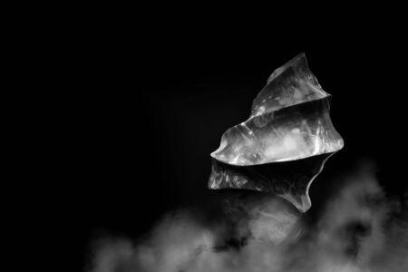 Beautiful polished spiral shaped piece of raw jasper in smoke, monochrome minimalist style