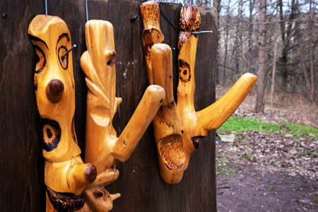 Decorative hanger, fancifully carved polished handcrafted tree knots at the open air fair