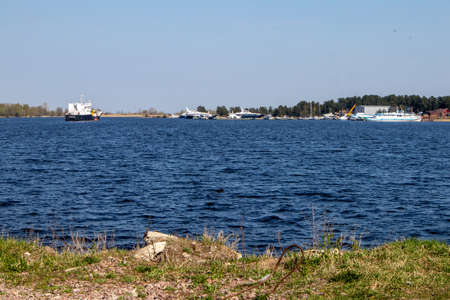 View of the water surface with light waves and pleasure yachts in the distance Фото со стока