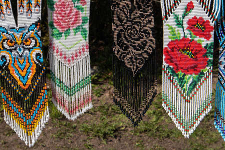 Few different bright beaded decorative pendants at the open air fair