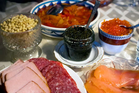 Home festive served table with red and black caviar and other different snacks