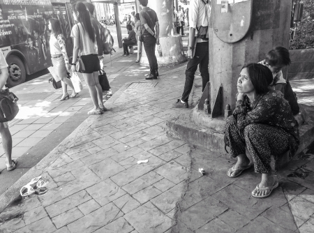 Homeless woman with child on the street, Bangkok, Thailand