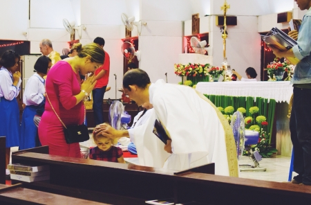 A priest blessed a child during a mass on Christmas night.