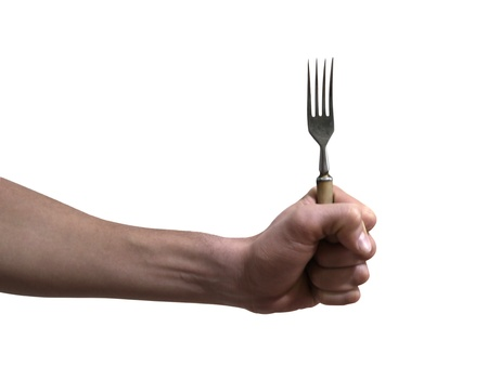 eat right: Fork in hand isolated on white background Stock Photo