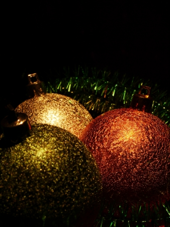 christmas balls on dark background photo