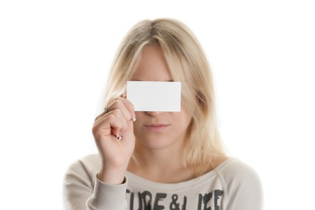 Girl with the business card in her hand covering her eyes isolated in white Stock Photo - 22928231
