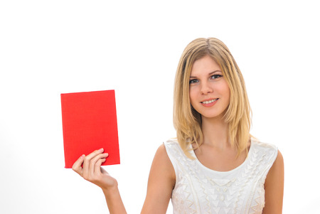 Young smart pretty girl holding the red book and smiling isolated on white photo