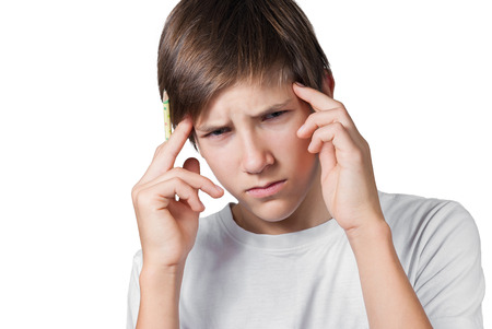 Portrait of little boy having a headache isolated on white Stock Photo