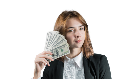 Portrait of young businesswoman with wad of money in her hands isolated on white photo