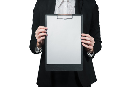 Portrait of businesswoman holding the clipboard in her hand isolated on white photo