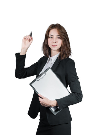 Portrait of businesswoman holding the clipboard and the pen in her hand isolated on white photo