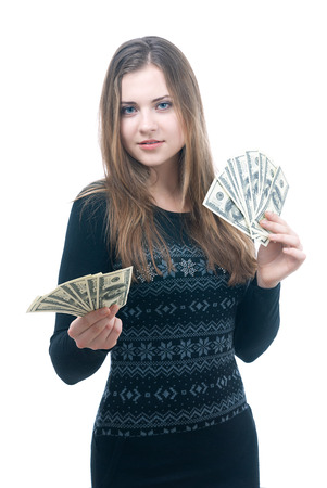 Portrait of happy young girl with wad of money in her hands isolated on white photo
