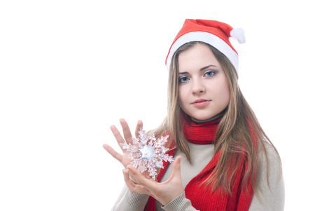 woman hanging toy: Portrait of girl with the toy snowflake in her hand isolated on white
