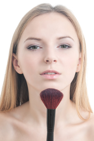 Beauty photo of girl with makeup brushes isolated on white photo
