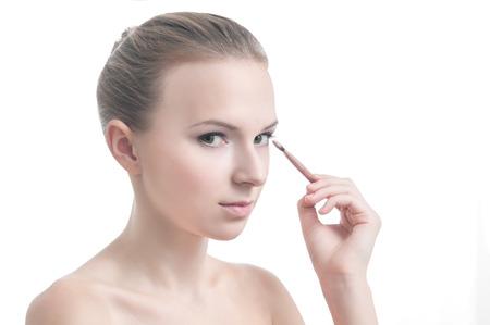 eyelid: Beauty photo of girl with eyelid brush, isolated on white