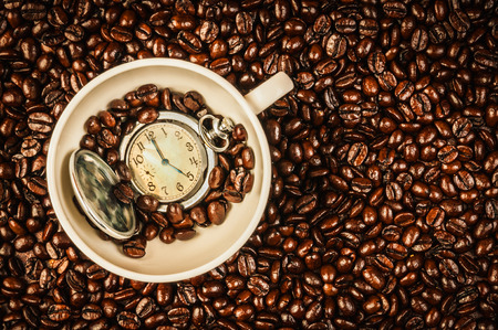 coffee cup and clock in it Stock Photo