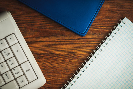 scratchpad: Composition with scratchpad, notepad and keyboard on the wooden desk Stock Photo