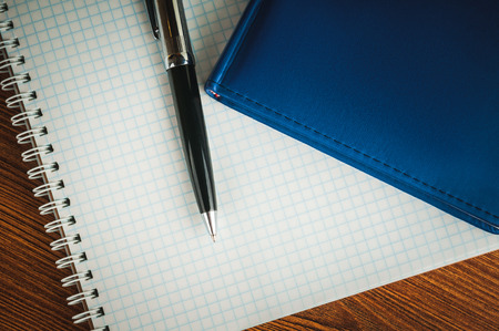 scratchpad: Blank notepad, pen, laying on it and notebook on office wooden table Stock Photo