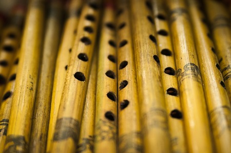 flutes: Photo of brown indian wooden flutes from the indian exhibition Stock Photo