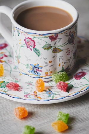 sweetmeats: Cup of cocoa and jujube on the wooden desk