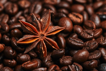 Coffee beans and star anise on the wooden table