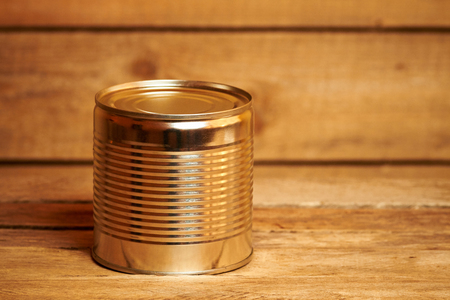 tin: Aluminum tin can on the wooden table