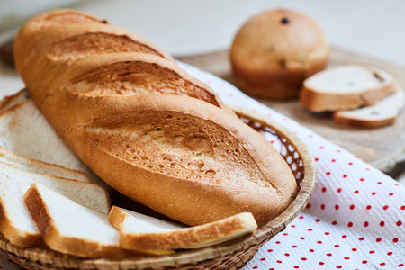 fresh white loaf of bread and cupcakes Stock Photo