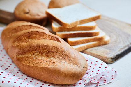 fresh white loaf of bread, toasts and cupcakes