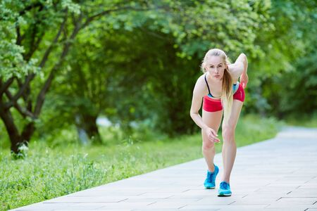 woman is jogging in the park on green background