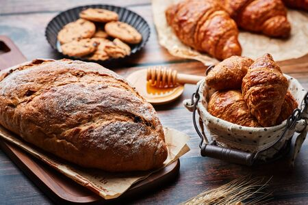 Miscellaneous delicious pastry on the wooden table Stock Photo