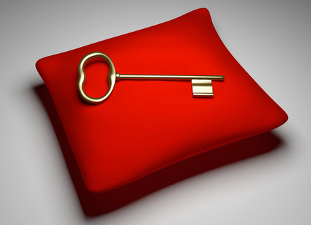 golden key: Golden Key lying on a red pilow in spotlight
