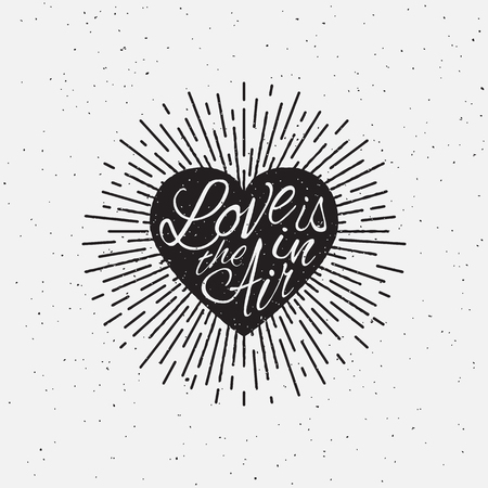 sloppy: Love is in the Air vintage grunge hand lettering with heart and rays for t-shirt apparel, print, poster, card design etc. Vector Illustration.