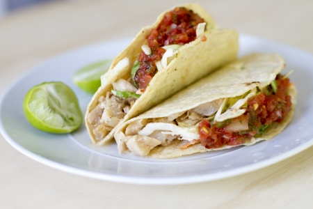 Marinated striped bass tacos with cabbage slaw, and fresh salsa. Banco de Imagens - 19414232