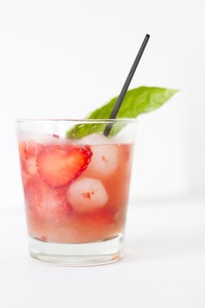 A refreshing strawberry, basil cocktail with a basil garnish