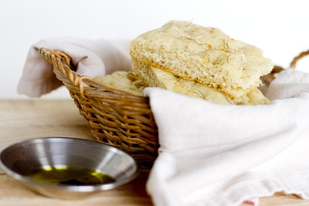 Several pieces of sliced focaccia bread with herbs.