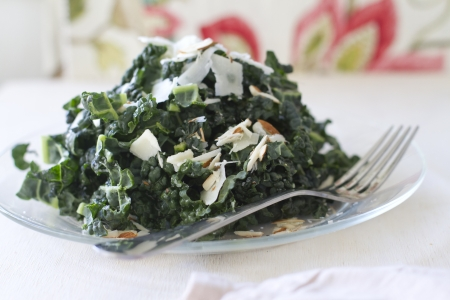 A Tuscan kale salad with parmesean cheese and almonds.