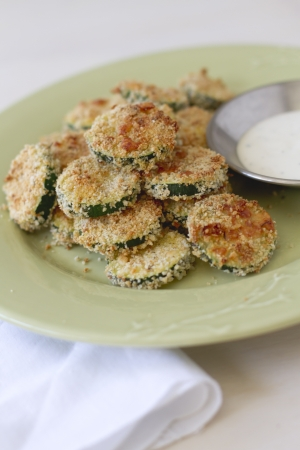 rounds: Breaded rounds of zucchini on a plate.