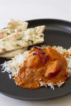 An Indian food dish of tikka masala and basmati rice.