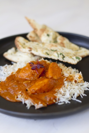 An Indian food dish of tikka masala and basmati rice. photo