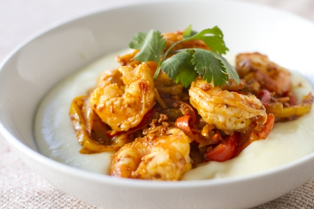 Chorizo, sweet pepper shrimp dish served over mashed potatoes.