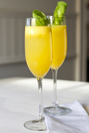nonalcoholic: Peach and basil non-alcoholic bellini in glassware. Stock Photo
