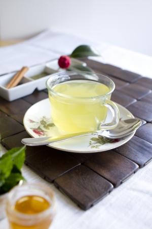 A tea scene with green tea, mint, and honey. Stock Photo