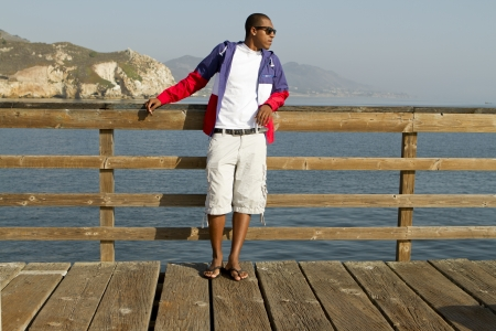 A hip African-American man on a pier.
