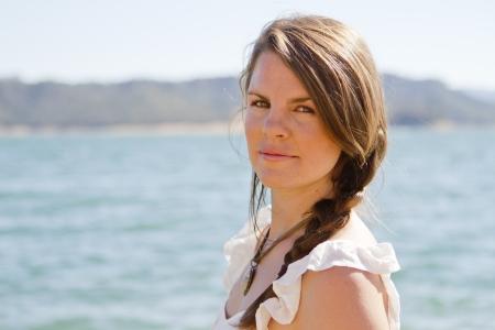 A young woman at the lake. Banco de Imagens