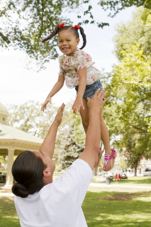 A young girl enjoys the afternoon with her family. Stock Photo