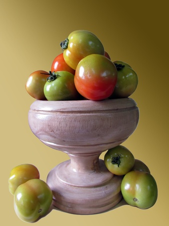 lycopene: Carved wooden vessel filled with fresh tomatoes.