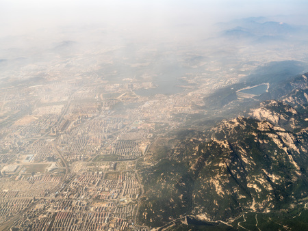 Aerial view of suburbs by a mountain Stock Photo