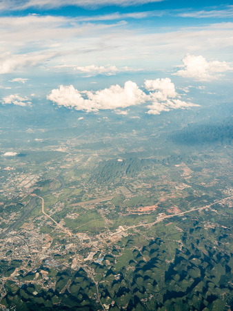High angle view of mountain and towns