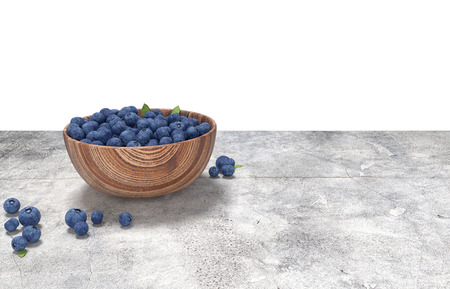 3D render. Wooden bowl full of blueberries on conrete table. Archivio Fotografico